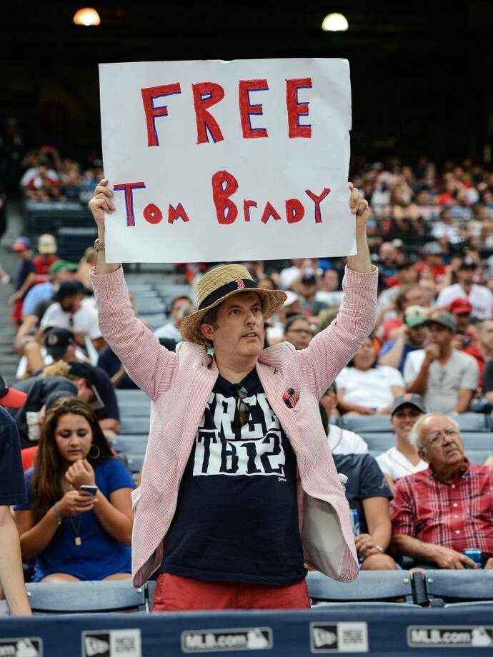 A fan holds a Free Tom Brady sign before the start of a game between the Atlanta Braves and the Boston Red Sox Thursday in Atlanta.