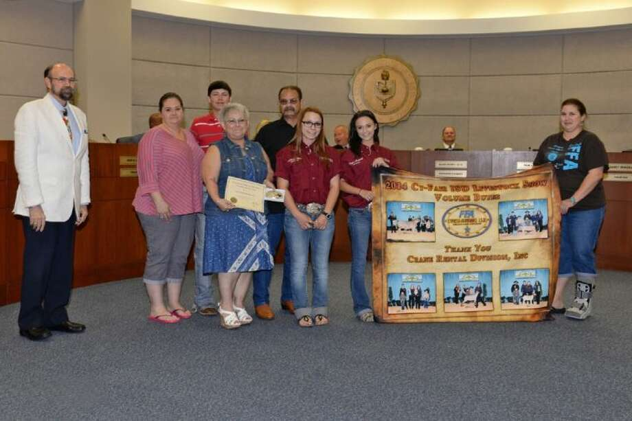 The CFISD Board of Trustees recognized Crane Rental Division, Inc., as the Livestock Show and Sale Top Volume Buyer during the June 26 Board of Trustees meeting. Pictured, from left, are Tom Jackson, Board vice president; Angela Francione, daughter of Top Volume Buyer; Tanner Francione, Cypress Falls student and grandson of Top Volume Buyer; Peggy and Sam Ferrugia, Top Volume Buyers; McKinzie Blissitt and Madison Pratt, Cy-Fair agriculture science students; and Erica Howard, mother of McKinzie Blissitt. Photo: Submitted Photo