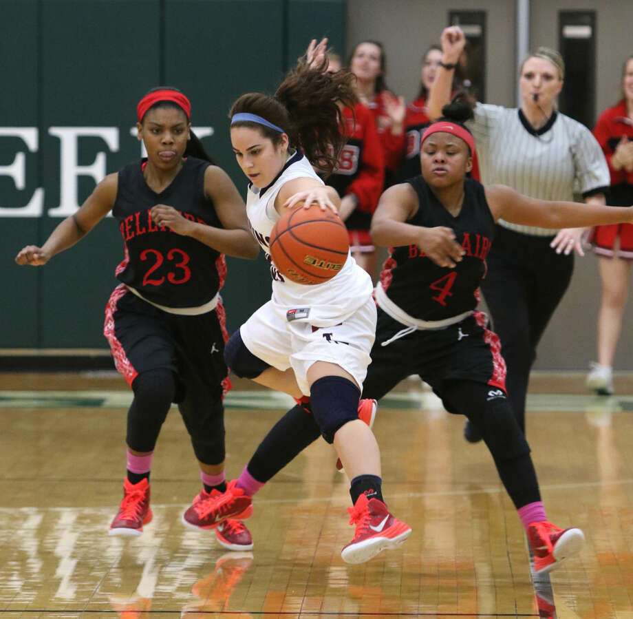 Tompkins' Sarah Goss chases down a loose ball against Bellaire's Audrianna Brown during their Bi-District Playoff, Feb. 16 at Mayde Creek High School in Katy. Tompkins won the game 63-62 in double overtime. To view or purchase this photo and others like it, go to HCNPics.com. Photo: HCN File Photo
