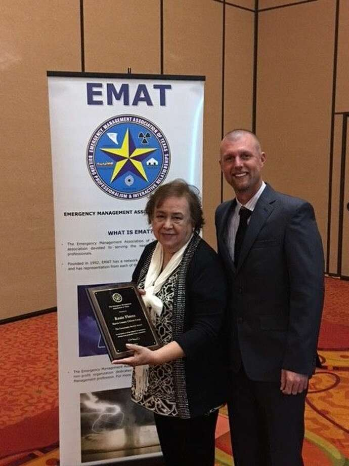 Harris County Teen CERT Coordinator Rosie Flores receives the EMAT Community Service Award from EMAT President Jeb Lacey on Feb. 9 in San Marcos.