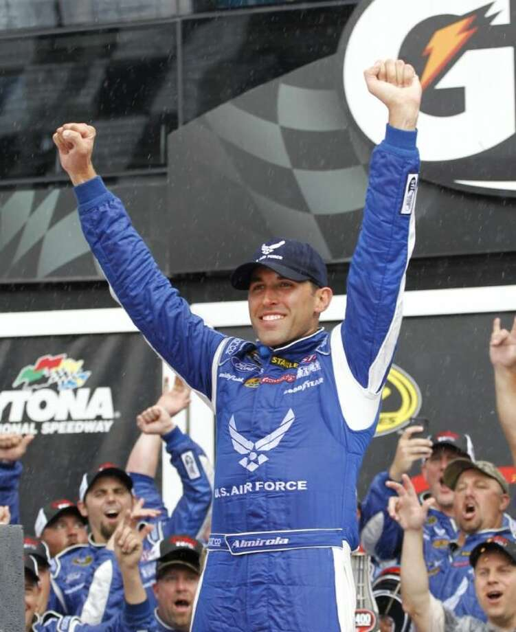 Aric Almirola celebrates after winning the NASCAR Sprint Cup Series race in Daytona Beach, Fla.