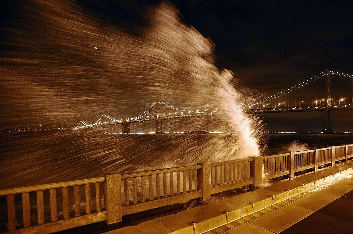 Waves break over the Embarcadero seawall near the foot of Howard St. on Saturday, Feb. 23, 2008, in San Francisco. BY NOAH BERGER/SPECIAL TO THE CHRONICLE