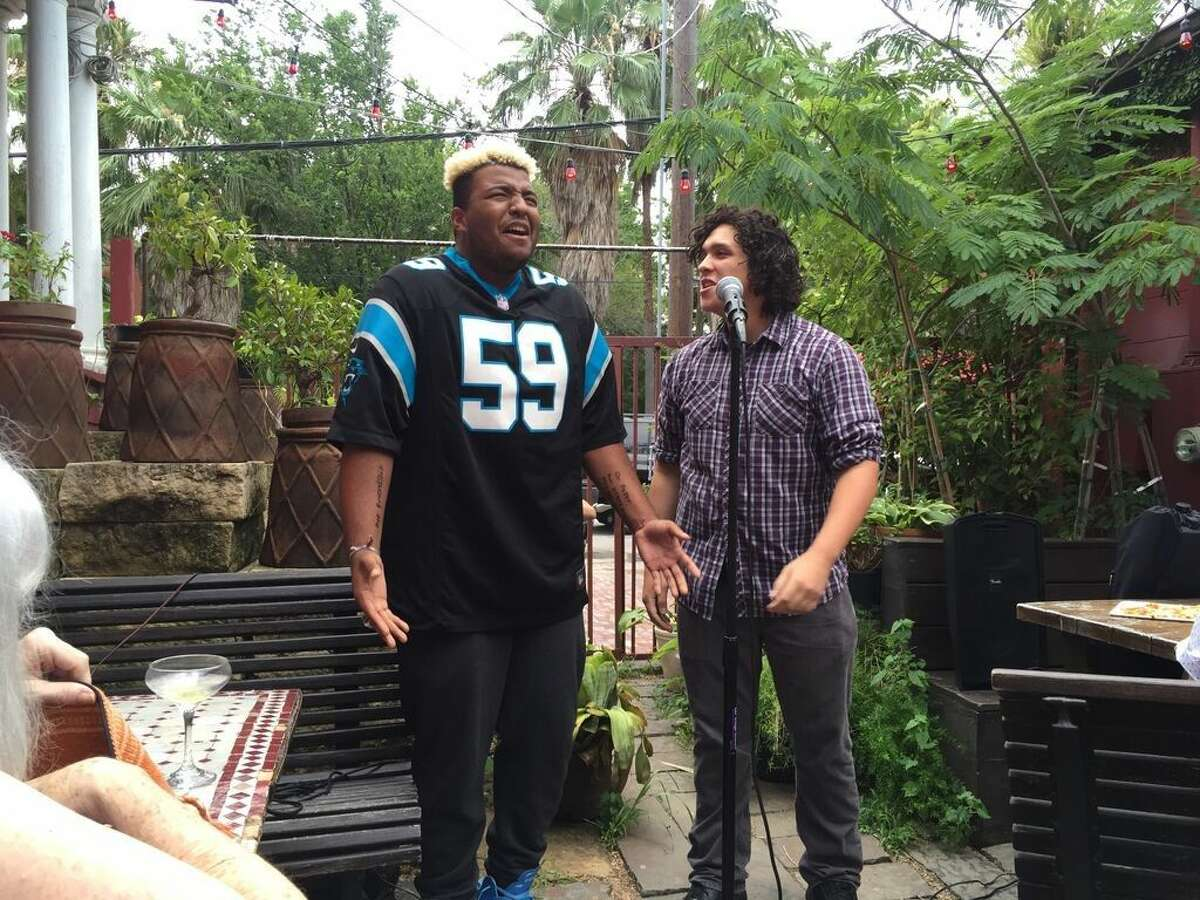 Carl Williams (left) and Marcus Rodriguez (right) perform at a poetry slam in Houston. There is a widespread renewed interest in spoken poetry for and by young people.