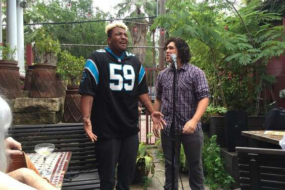 Carl Williams (left) and Marcus Rodriguez (right) perform at a poetry slam.