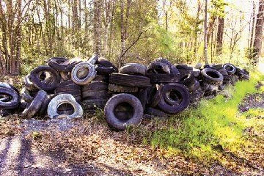 Precinct 4 works to clear tire dumpsites.