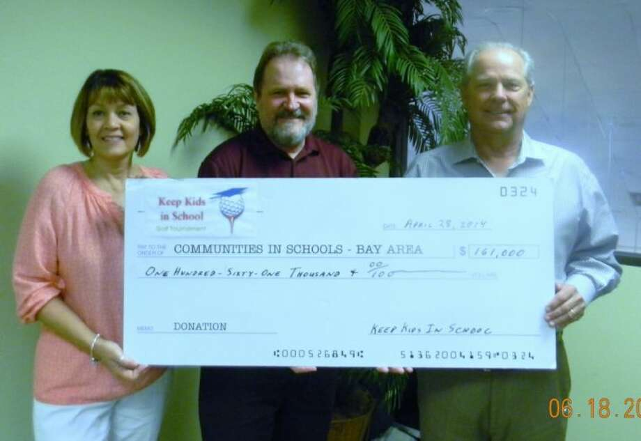 Rick Gornto (right), chairman of the Keep Kids in School Golf Tournament, presents the 161,000 check to Communities In Schools-Bay Area's Peter Wuenschel, executive director of the dropout prevention program and Jane Sweeney, president of the board of directors.