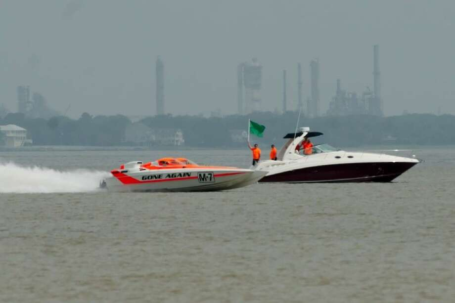 "The offshore racing skater powerboat ""Gone Again"" gets the green flag for a run to surpass speeds of 200 MPH during the Texas Outlaw Challenge 100+ MPH Shoot-Out boat race on Galveston Bay Friday, June 19."