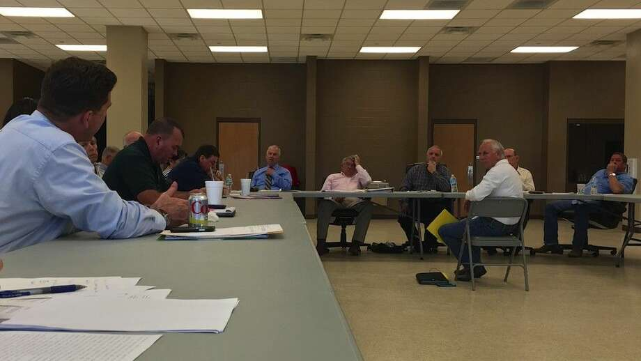 Dr. John Johnson, seated at center, listens as Pct. 1 Commissioner Mike McCarty and County Attorney Wes Hinch discuss the uses of 380 and 381 tax incentives during a Liberty County Commissioners Court workshop held Wednesday afternoon, Feb. 17, at the Hartel Building in Liberty, Texas. Photo: Casey Stinnett