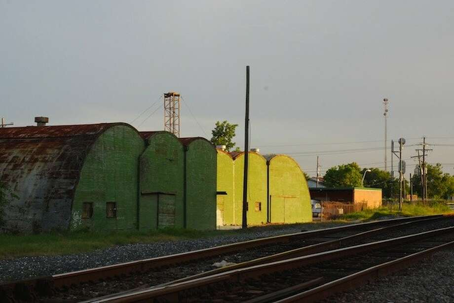 One of Dayton's more noticeable landmarks may soon be gone. According to information provided in the July 7 City Council meeting, the owner of the green quonset huts has indicated he will tear them down if the City builds a parking lot on property next door donated by Boyd Arnold. Photo: CASEY STINNETT