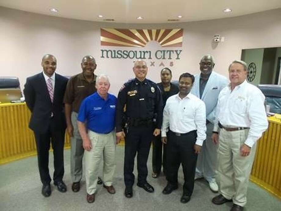 Missouri City Council with Police Chief Mike Berezin soon their vote to appoint him to the position at their July 7 meeting. (Left-right:) Councilmembers Chris Preston, Jerry Wyatt and Floyd Emery, Berezin, Councilmembers Yolanda Ford, Robin Elackatt, Don Smith and Mayor Allen Owen. Photo: Photo Courtesy Missouri City