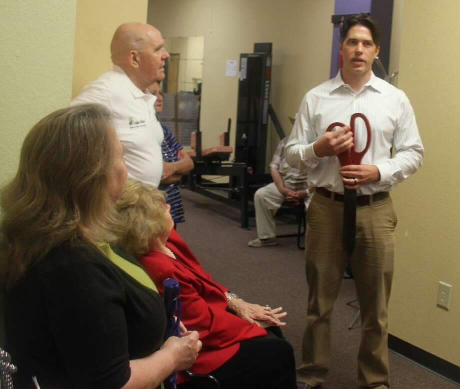 Brad Perry (right) is the owner of Cleveland Physical and Occupational Therapy. Here he gives a brief tour of the facilities located on 102 N. Travis St. Photo: Jacob McAdams