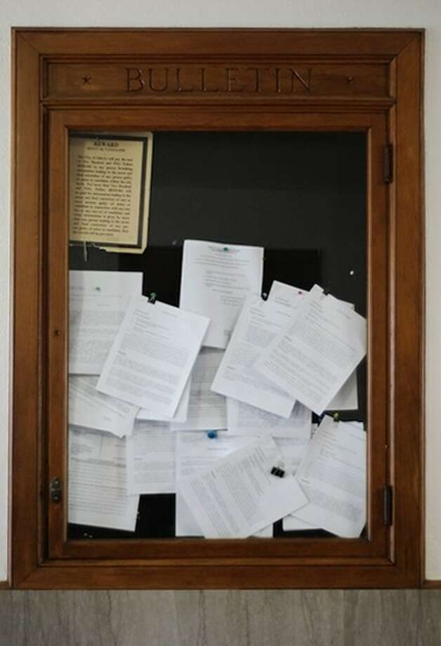 In Liberty County, as is done in every rural courthouse, legal notices are posted in a manner fulfilling the letter, if not the spirit, of the law. Photo: CASEY STINNETT
