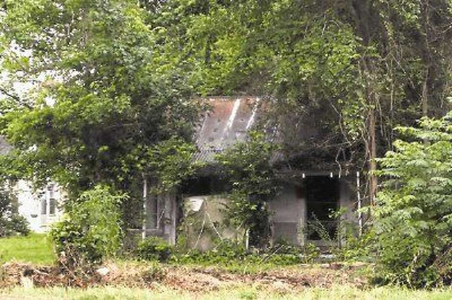 Dayton City Council approved an order to demolish the dilapidated structure at 3407 SH 321, near the high school. Photo: Casey Stinnett
