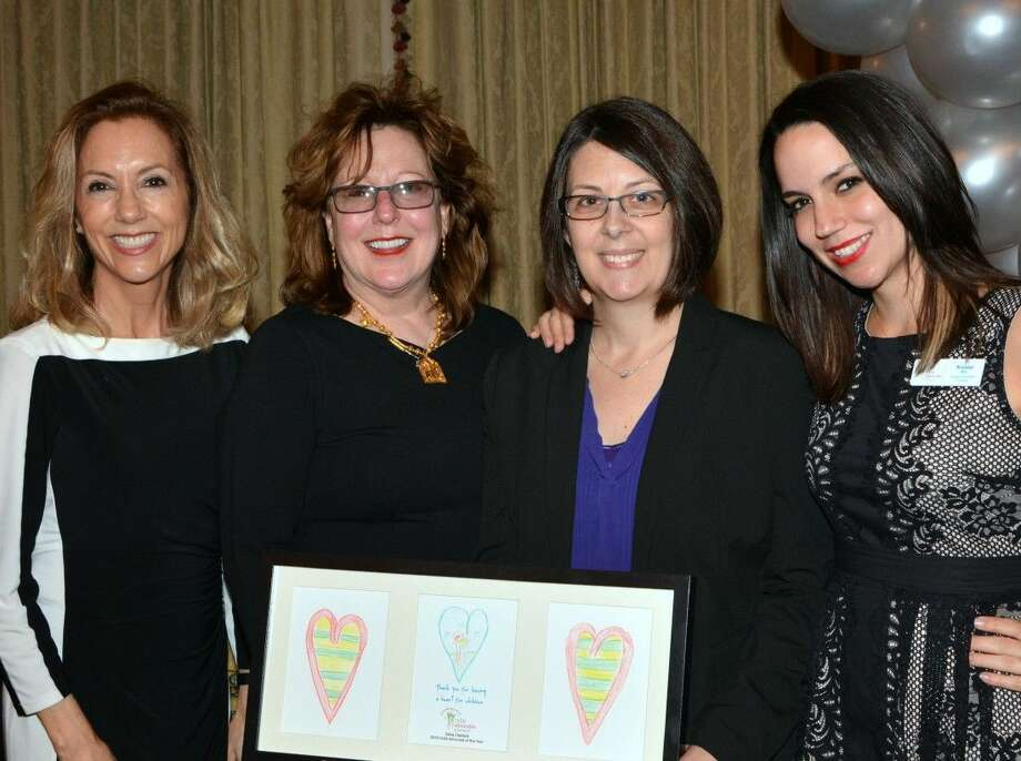 Child Advocates of Fort Bend CEO Ruthanne Mefford, Board President Cynthia Barratt, Dana Clement and Child Advocates of Fort Bend CASA Program Development Coordinator Krystal Vann. Clement was honored as Child Advocate of the Year during the agency's annual volunteer banquet Feb. 18. Photo: Sue Lockwood