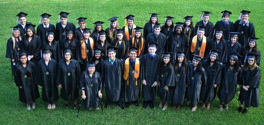 The ACC Dual Degree graduates pose for a photo before walking the stage during Commencement on May 20.