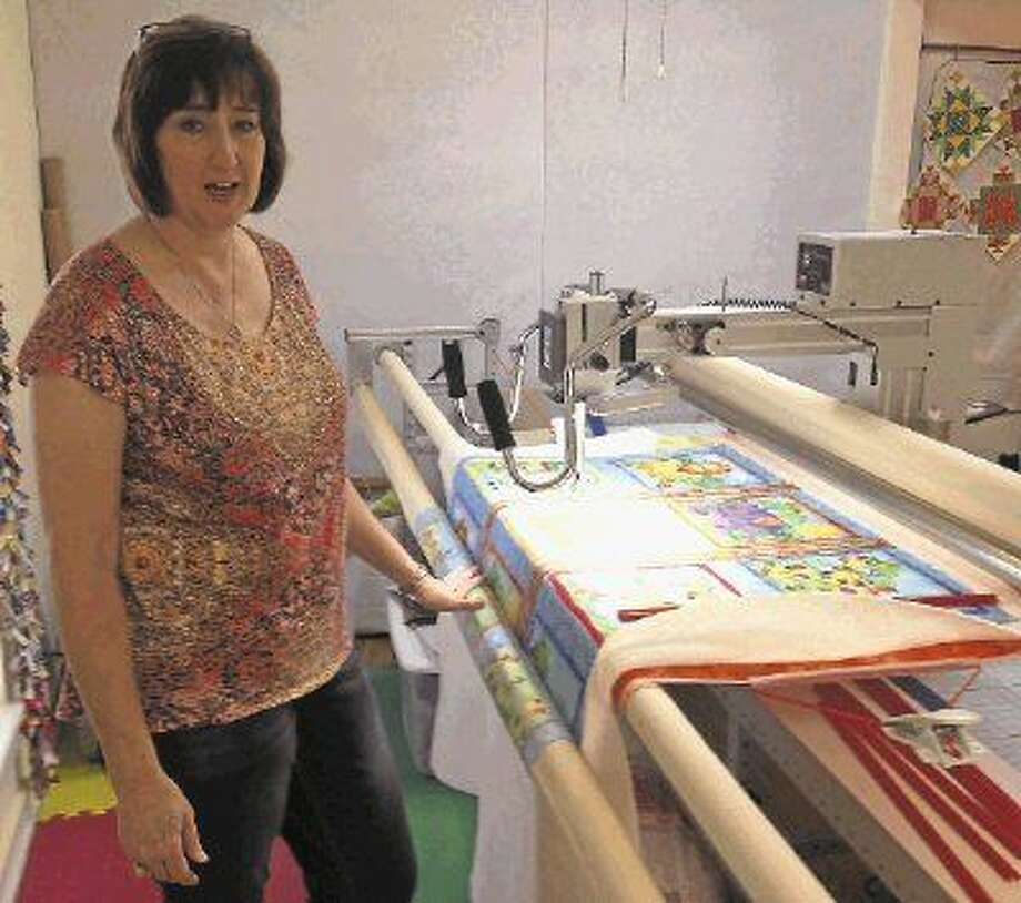 LaDonyce Hamilton displays her longarm sewing machine, which she uses to create quilts. Photo: Jacob McAdams