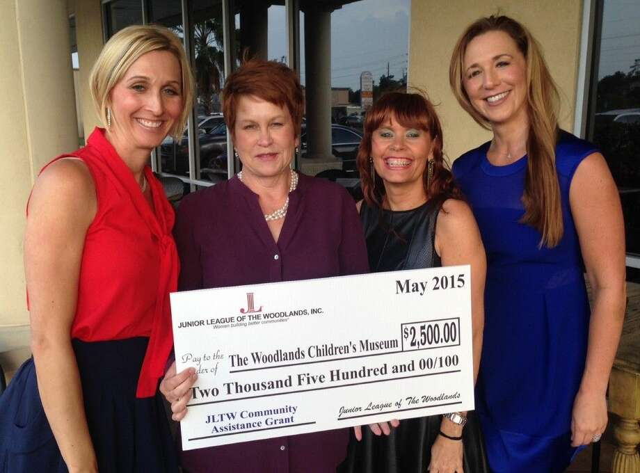 From left, Julia Dell, 2014-2015 president of the Junior League of The Woodlands, presents a Community Assistance Grant in the amount of $2,500 to Chrisanne Christensen, accepting on behalf of The Woodlands Children's Museum, with Bobbi Jo Miller, community vice president, and Ashley Boudreaux, 2015-2016 president of Junior League of The Woodlands.