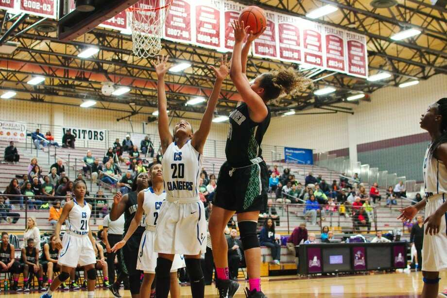 Chelsea Lott and Hightower won District 23-6A and the area championship during the 2014-15 season. The Lady Hurricanes defeated Clear Lake and Pearland in the playoffs. Photo: Staff Photo By Kirk Sides