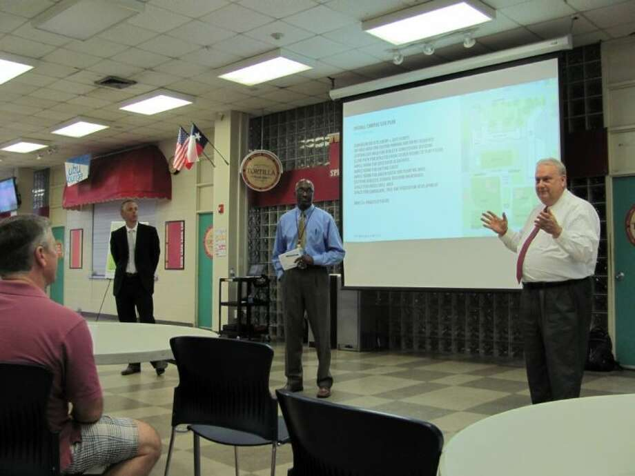 From left, architect Patrick Glenn with Perkins + Will, program manager Marvin Stone with Heery International and Lamar High Principal Dr. James McSwain discuss highlights of the proposed design for the school campus, which is being rebuilt as part of Houston ISD's 2012 bond program.