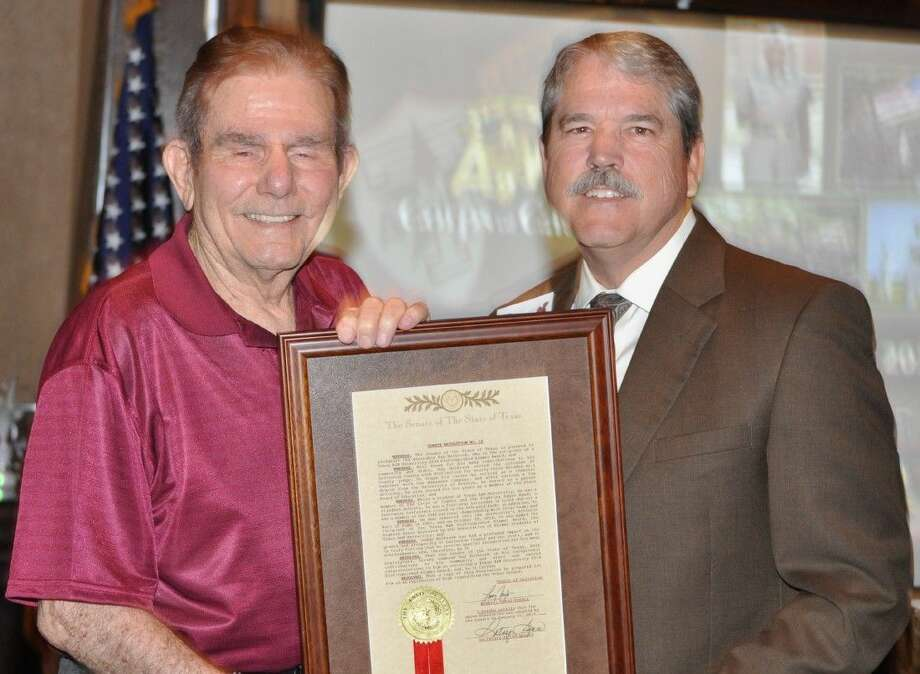 Senator Larry Taylor (R) Presents A&M's Distinguished Alumni Award to Judge Ray Holbrook praising him for more than 30 years' service to the community as a Judge in Galveston County.