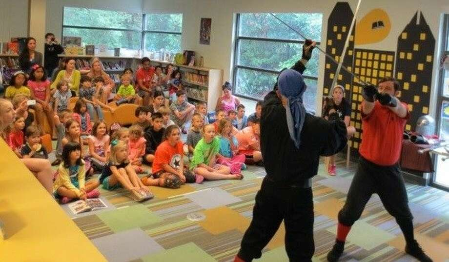 Renaissance Martial Arts warrior Kyle Cook and his faithful squire, Stacy Clifford, explained the art of Renaissance swordsmanship to guests at the Kingwood Branch Library.