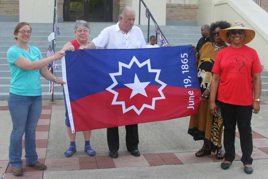 Members of the San Jacinto County Historical Commission and Ester Elmore-Wynn display the Juneteenth flag. Pictured left to right are Rebecca Hammond, Cora Standly, Dale Everitt, Dorothy Donahoe and Elmore-Wynn. Photo: Jacob McAdams