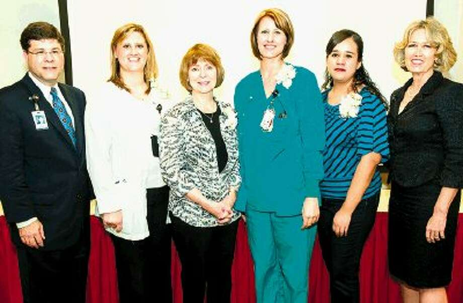 Chief Executive Officer Louis Smith (left) and Chief Nursing Officer Linda Stephens (right) recognized Memorial Hermann Northeast Hospital's 2014 Healthcare Excellence award winners (from left), Jenna Mendoza, Kathy Kelsoe, Jennifer Cox-Scott and Yesenia Garcia.