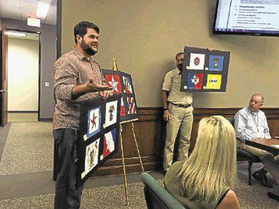 Liberty Middle School art teacher J. D. Humber addressed the Liberty City Council Tuesday evening, June 9, to propose that the City adopt a city flag, and he brought with him flag designed created by his students. Photo: Casey Stinnett