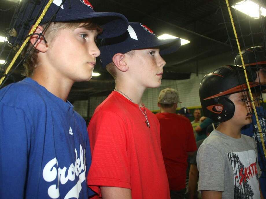 The NASA-West trio of (L-R) Colton Ogden, John Davis and Jerry Tramburello wait to take their cuts in one of the 3K Sports batting cages last week. Photo: Robert Avery
