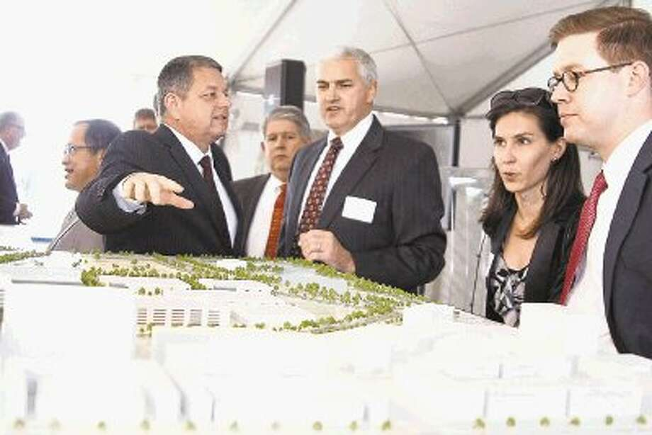 Employees visualize the future FMC Technologies campus and Generation Park during the ground breaking ceremony May 2, 2014. / @WireImgId=2673959