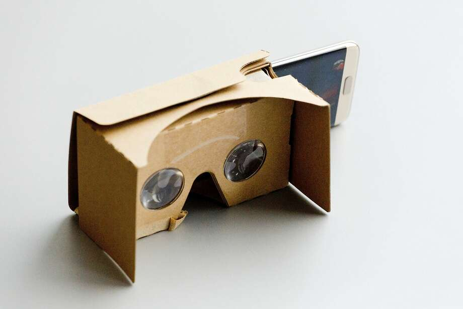 Google's Cardboard viewer makes VR affordable for smartphone users. Photo: Mark Lennihan, AP