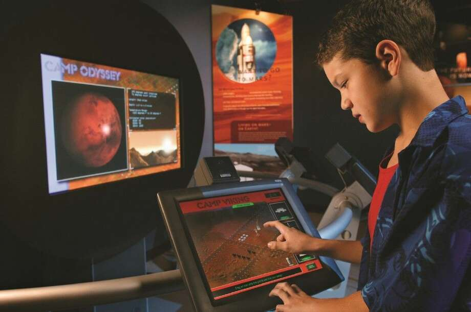 "Visitors will learn about the race into deep space with interactive exhibits in Space Center Houston's summer exhibit, ""Space: A Journey to Our Future,"" through Sept. 7. Photo courtesy of Evergreen Exhibitions."