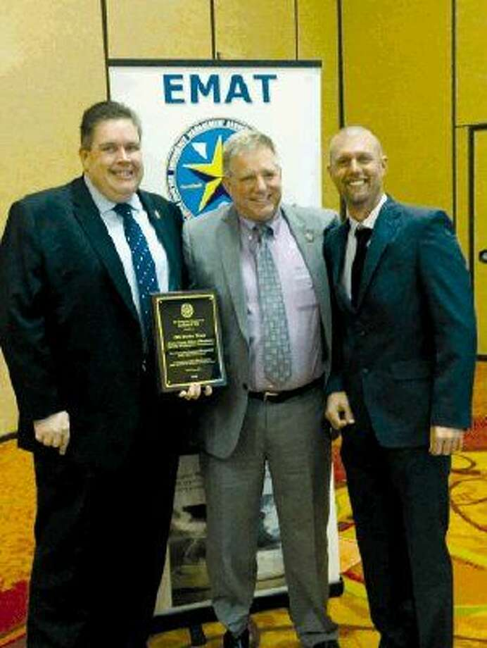 Harris County Office of Homeland Security & Emergency Management received Outstanding Emergency Management Public Information Award from EMAT Feb. 9. Pictured from left to right are Brian Murray, HCOHSEM; Mark Sloan, Harris County Emergency Management coordinatorand Jeb Lacey, EMAT president.