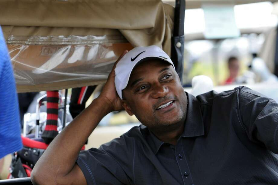 FILE - In this Nov. 11, 2011, file photo, former professional baseball player Darryl Hamilton sits in a golf cart at the Urban Youth Academy Celebrity Golf Classic, hosted by Ron Washington and Chad Gaudin, at English Turn Golf Course in New Orleans. Authorities say Hamilton was killed Sunday, June 21, 2015, in a murder-suicide in the Houston suburb of Pearland, Texas. Pearland police say an initial investigation has determined Hamilton had been shot several times and that a woman in the home died of a self-inflicted gunshot wound. The woman was identified as Monica Jordan. (Cheryl Gerber/AP Images for MLB, via AP, File) Photo: Cheryl Gerber