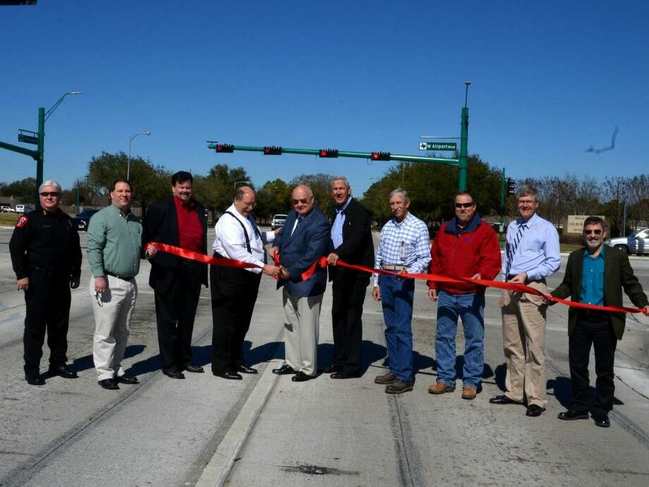 Police Chief Gary Stewart, Alderman Rick Staigle, Alderman John Isbell, Mayor Charles Jessup, County Judge Bob Hebert,Commissioner Pct 4, JamesPatterson, Stephen Leffingwell (TxDOT), Bobby Cayton Jr (TxDOT), Edwin Rydell (HDR), Terry Maher (HDR). Photo: Picasa