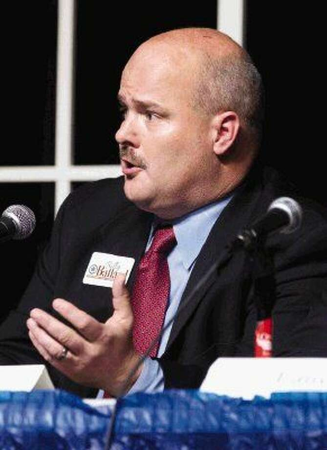 Billy Ballard, candidate for Precinct 1 Constable, speaks during a candidate forum for various local, state and national races at the Crighton Theatre Wednesday, Dec. 16, 2015, in Conroe.