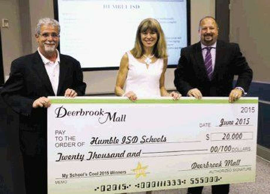 On Tuesday, June 9, Deerbrook Mall celebrated area schools with the presentation of a $20,000 My School's Cool check to the Humble Independent School District (HISD). Pictured from left to right are Dr. Guy M. Sconzo, HISD superintendent; Sandy LaClave, senior general manager of Deerbrook Mall and Robert Sitton, Humble ISD Board of Trustees president.