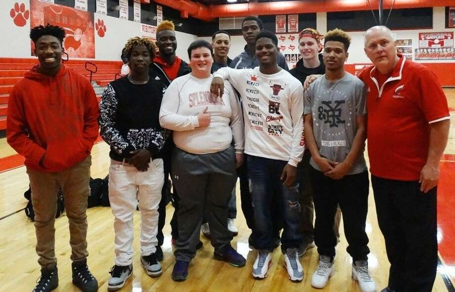 "The Coldspring Trojan basketball team helped make Splendora senior Zach Mills' dream come true during the game against Splendora on Tuesday, Feb. 9. Pictured from left to right are (back row) Edward Hayes, Cadarrius ""Tunk"" Harrison, Ave-on ""Red"" Gilbert, and Brett Lewis; (front row) Anthony Richard, Terrance Griffin, Zach Mills (Splendora), Trey Cole, Baxter Smith and Coach Devers. Photo: Submitted"