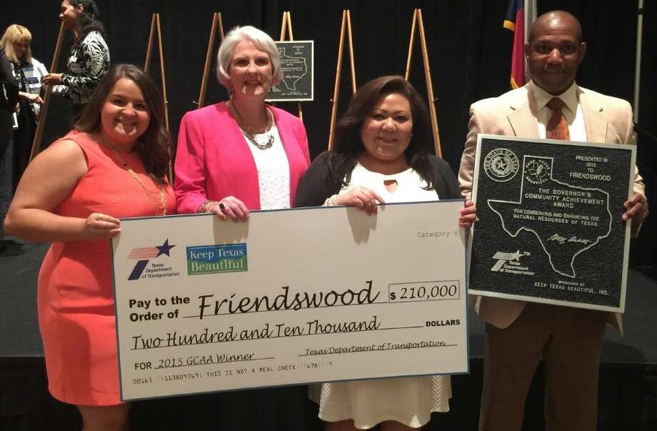 Sherry Goen, Chairperson of Keep Friendswood Beautiful (second from left), and City of Friendswood Parks and Recreation staff members (from right) James Toney, Kimberly Ramirez and Katy Blanchard accept the 2015 Governor's Community Achievement Award in Fort Worth on Tuesday (June 16).