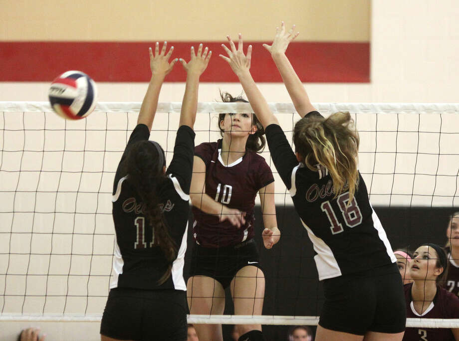 Cinco Ranch's Nicole Lennon spikes against Pearland during the Spring Branch ISD 2014 Varsity Tournament, Aug. 21 at Memorial High School in Houston. The Lady Cougars won District 19-6A and the area championship. Photo: HCN File Photo