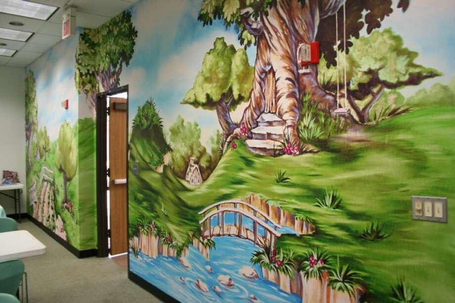 A floor-to-ceiling, corner-to-corner, arboreal-themed mural was donated by Richard and Joanne Jacobson with the approval of the Friends of the Atascocita Library (FOAL).
