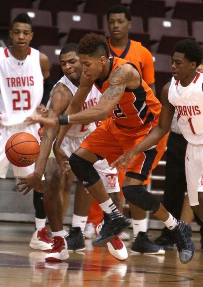 Former Bush forward Kelly Oubre and Travis graduate Aaron Harrison played against each other several times, including the 2013 Region III-5A championship game. Both could be selected June 25 in the NBA Draft. Photo: HCN File Photo