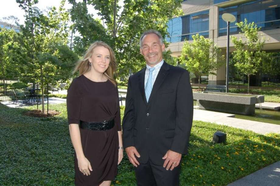 Sarah Rhea, executive director of Leadership Montgomery County, welcomes Bret L. Strong, founder and managing shareholder of The Strong Firm, to the LMC board of directors.