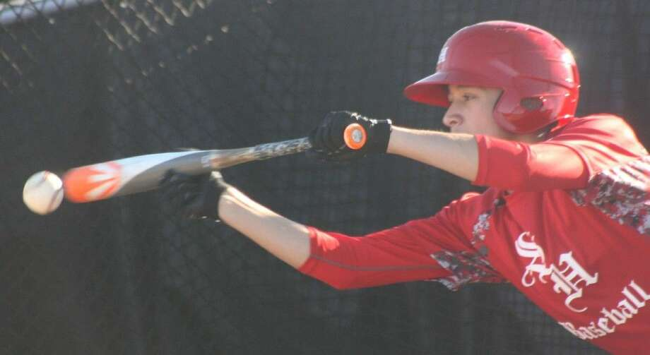 South Houston's Andy Rodriguez works on his bunting during a Thursday afternoon practice. The Trojans are working extra hard because the 22-6A opener sits just nine days away. Photo: Robert Avery
