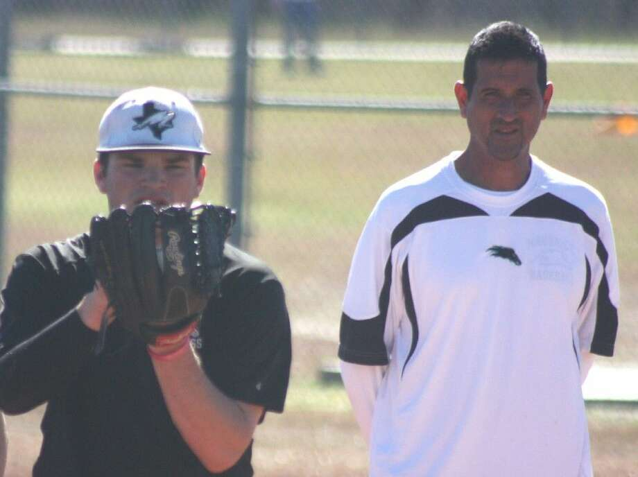 Mavs baseball head coach Terry Garza watches returning all-district pitcher Logan Portis prepare to throw a pitch during practice this past week. The pitching should help Memorial be playoff contenders this spring. Photo: Robert Avery