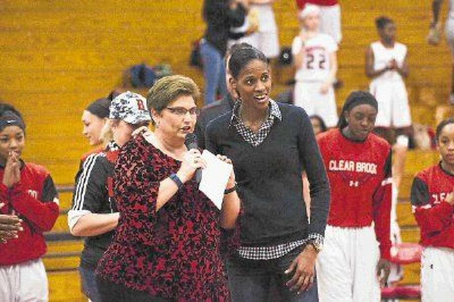 Former Baylor University and WNBA player and former Clear Brook basketball player Chameka Scott is introduced by Clear Brook Athletic Trainer Cathy Supak during a pre-game ceremony in Scott's honor Friday, Feb. 6. Photo: KIRK SIDES