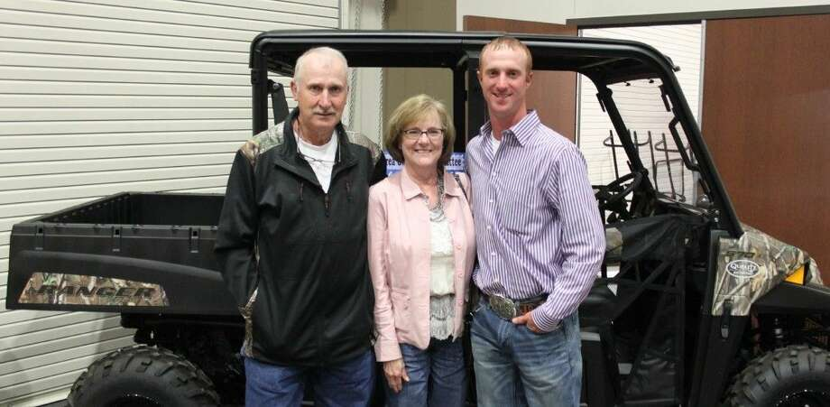 Jan Robison (middle) won the Polaris Ranger at the San Jacinto County Go Texan auction and dinner on Feb. 13. Pictured left to right are Landry Robison, Jan Robison and Jarrett Robison. Photo: Jacob McAdams