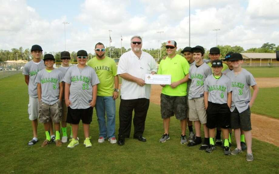 Fred Arnold with Minute Maid Park donated funds to the Montgomery County Ballers, along with Coach Travis Moore, to help the kids play in an upcoming tournament. Photo: Submitted Photo