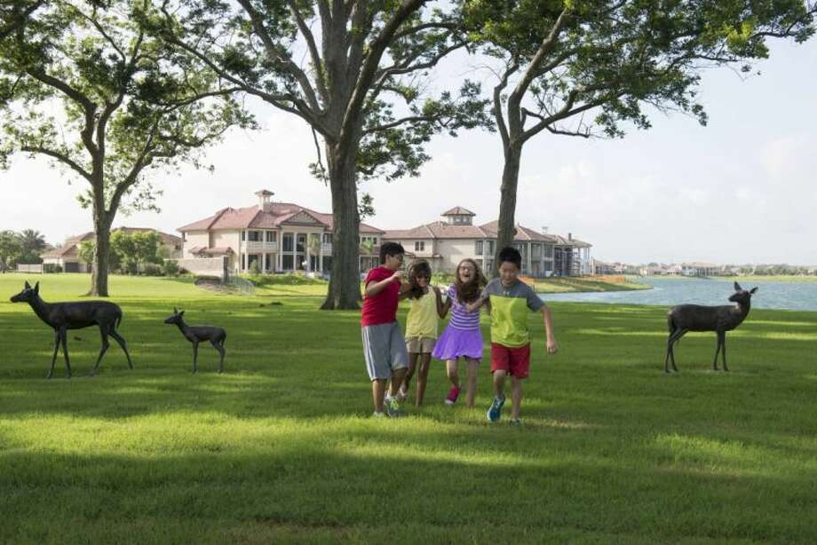 With nearly 400 new home sales during the first half of 2014, Riverstone is now ranked No. 4 among the nation's top-selling master-planned communities, up two spots. Nine Houston-area developments are on the mid-year list, compiled by Robert Charles Lesser & Co. Photo: Submitted Photo