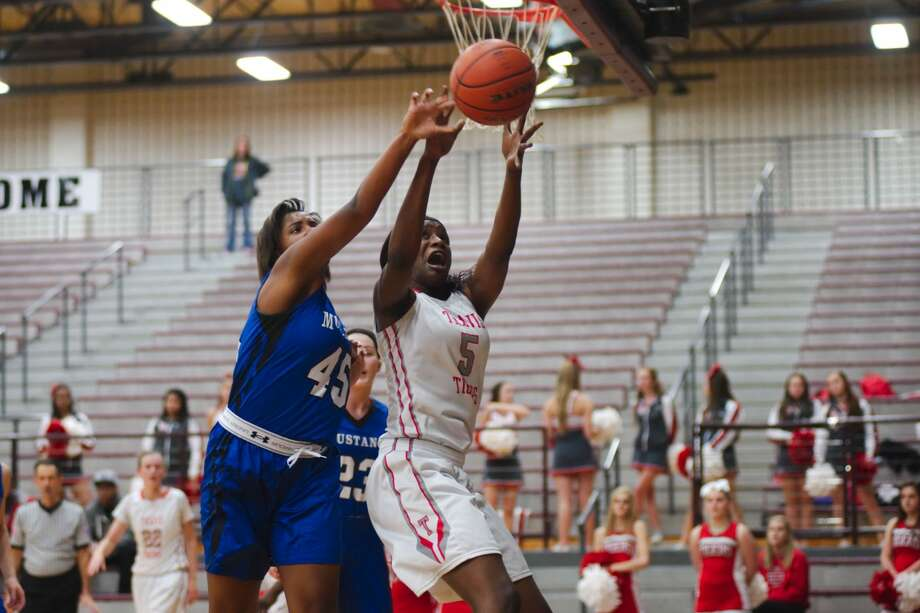 Travis' Queen Egbo recorded 22 points and 17 rebounds in a Class 6A bi-district game against Clear Falls. The Lady Tigers made their third straight playoff appearance.